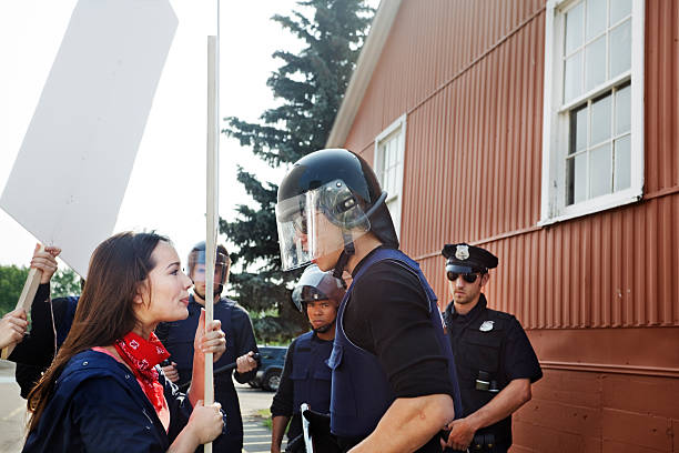 Protester tries to interrupt officer stock photo