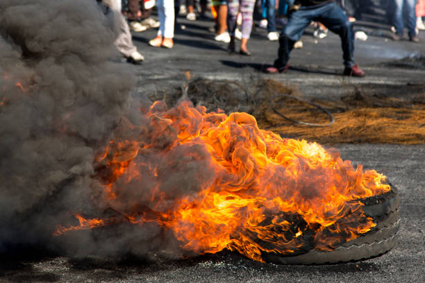 Protesters against the government burning rubber tyres in the streets in South Africa Protesters against the government burning rubber tyres in the streets in South Africa riot stock pictures, royalty-free photos & images