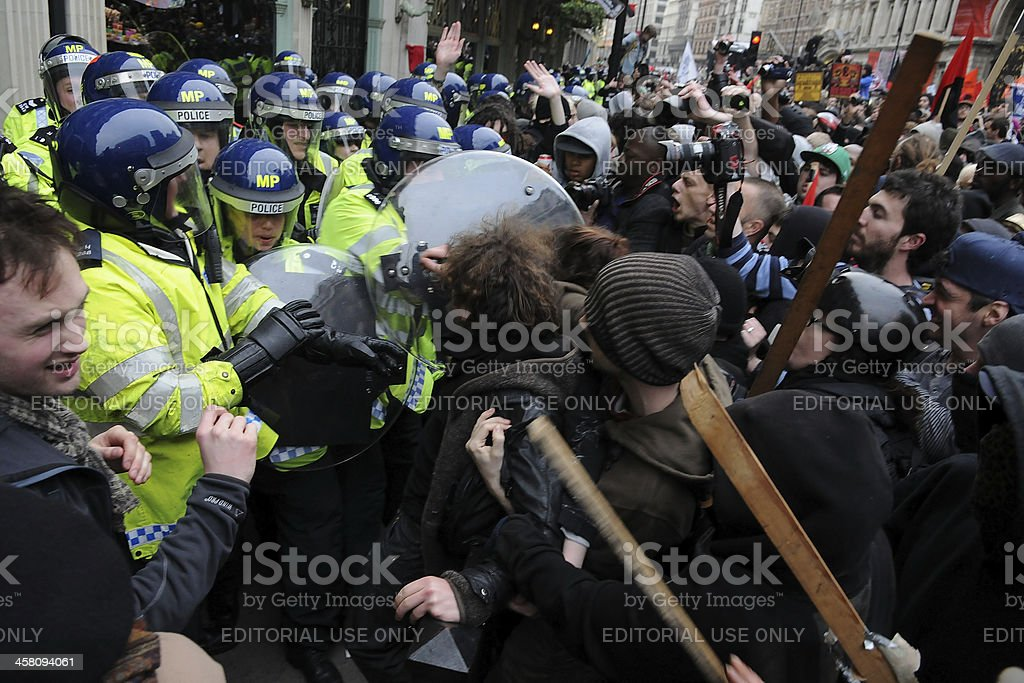 Protesters and Police Clash at an Austerity Rally in London royalty-free stock photo