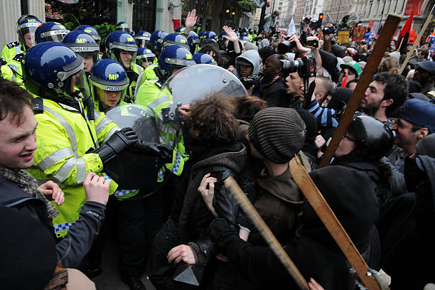 Protesters and Police Clash at an Austerity Rally in London stock photo