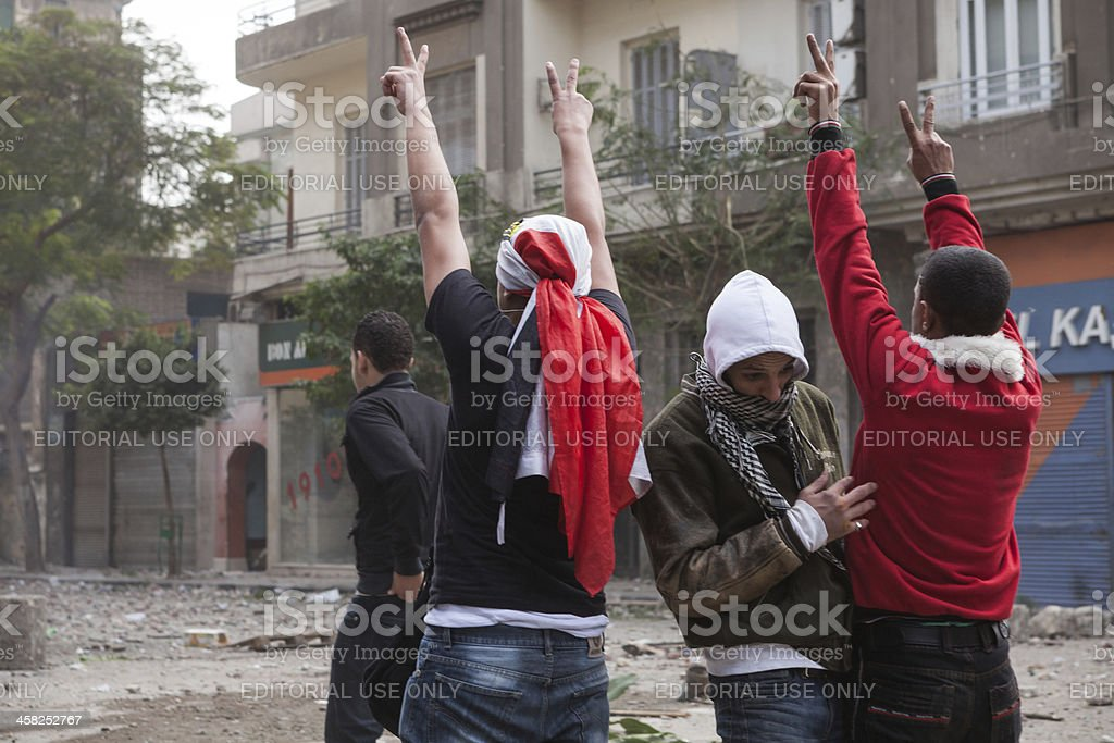Protesters are doing victory sign at the police stock photo