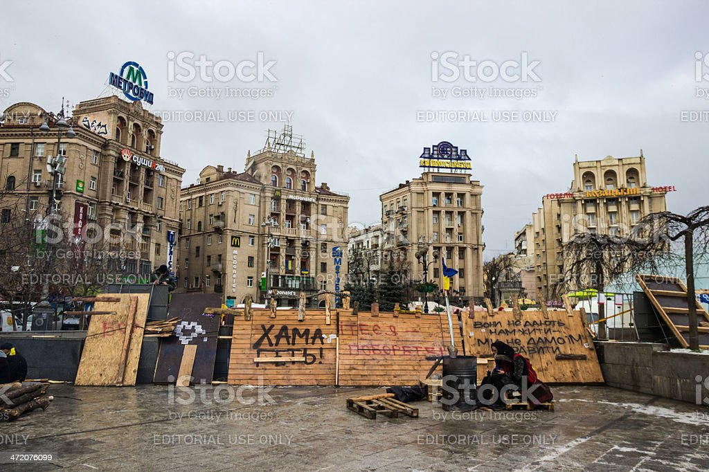 Protesters are heated by fire on Maidan in Kiev royalty-free stock photo