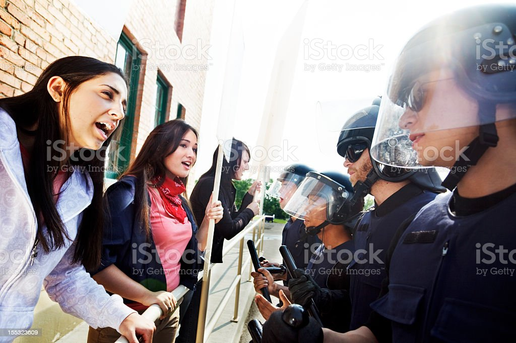 Protesters argue with police stock photo