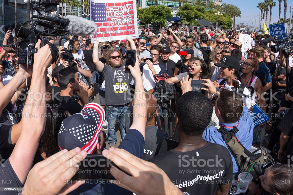 Protesters clash in verbal conflict San Diego, California, USA - May 27, 2016: Huge groups of protesters clash with Trump supporters in a verbal exchange outside a Trump rally at the San Diego Convention Center. American Culture Stock Photo