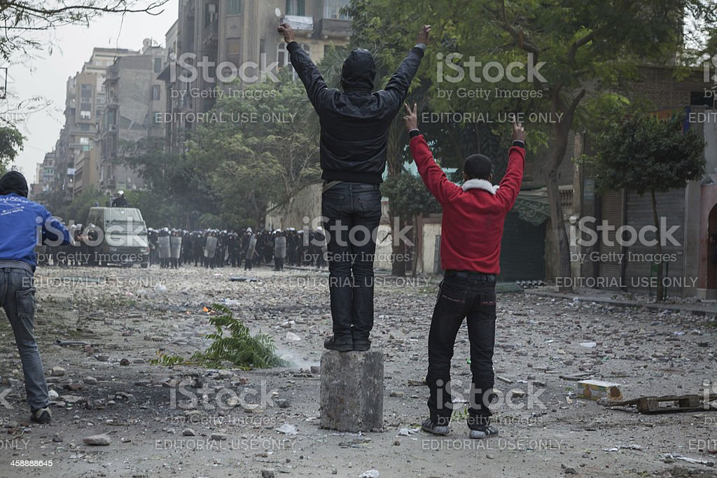 Protesters doing victory sign at the police stock photo