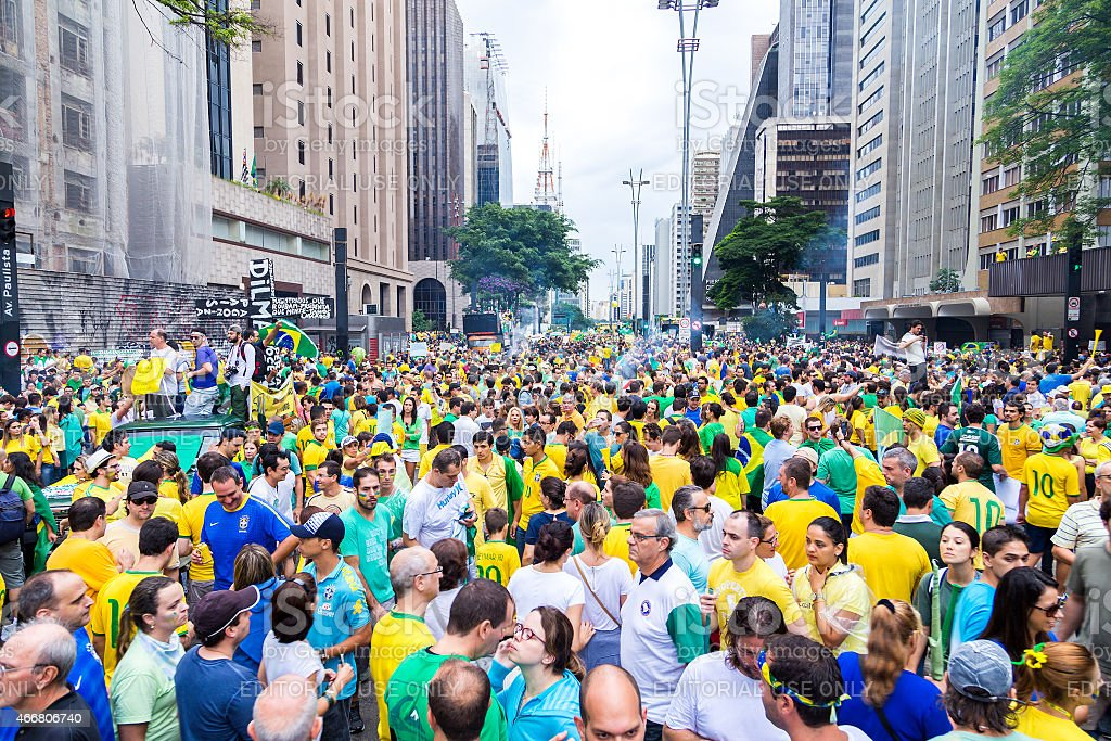 Protesters marching on Paulista Avenue against the corruption stock photo