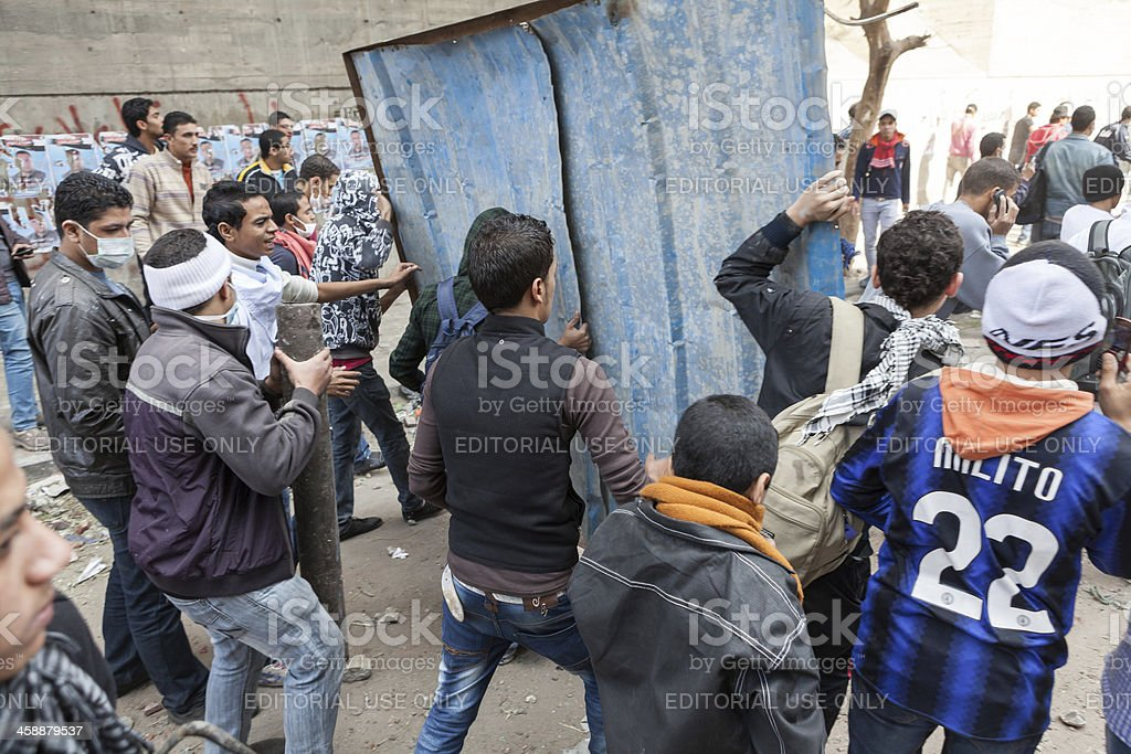Protesters rebuilding their barricade royalty-free stock photo