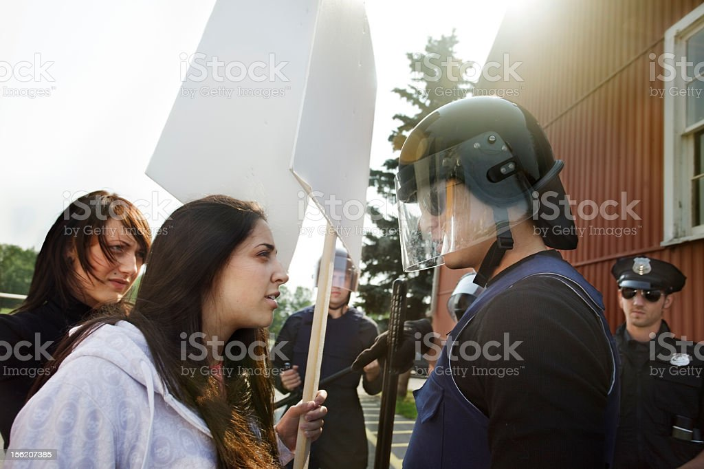 Protesters try talking to the police stock photo