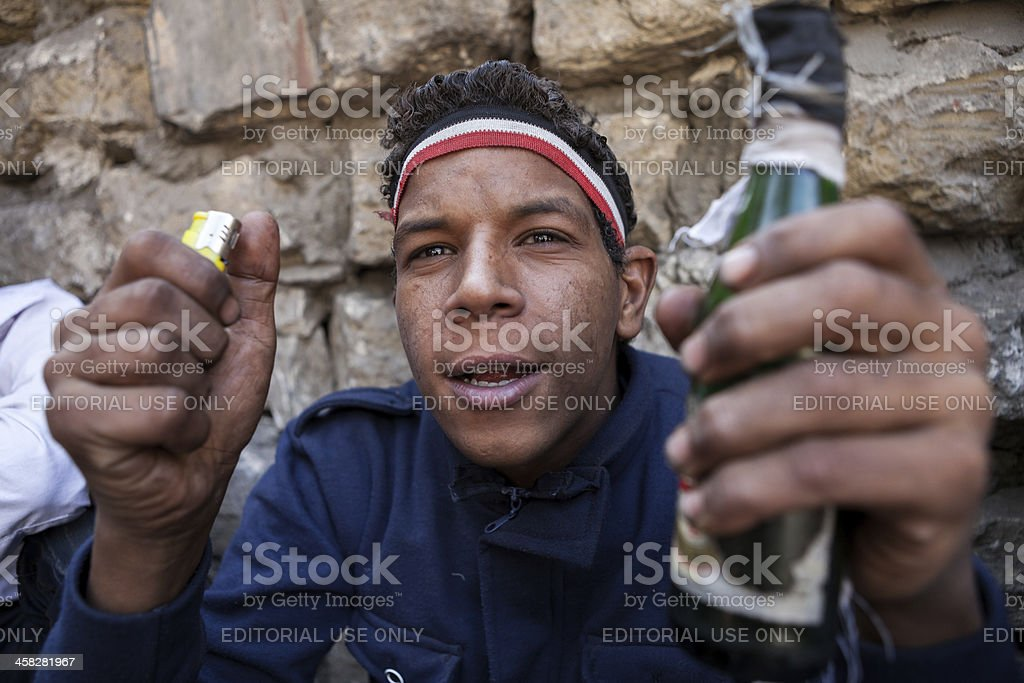 Protestor in Cairo with Molotov Cocktail stock photo
