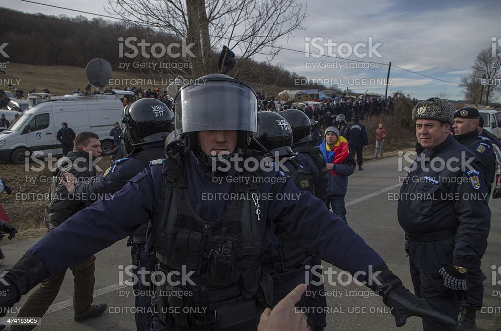 Protestor, Riot Police and Officer stock photo