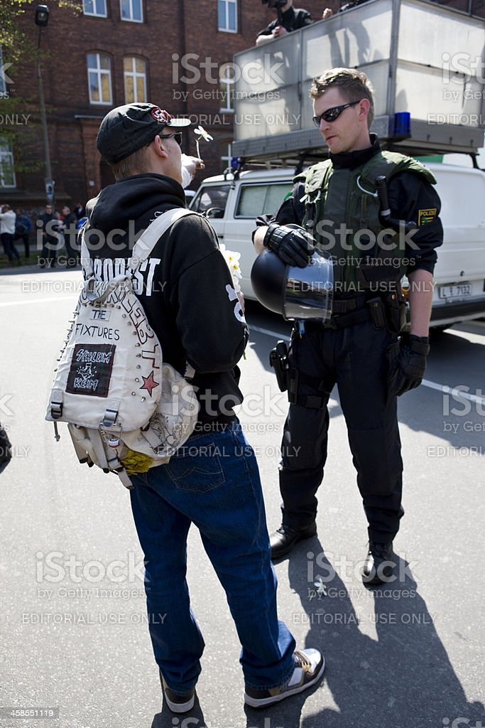 protestor talking to police officer royalty-free stock photo