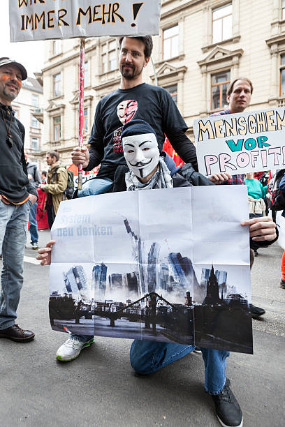 protestors at blockupy 2013 demonstration, frankfurt - guy fawkes mask stock photos and pictures