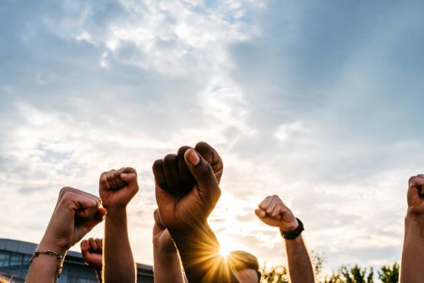 Protestors raising fists stock photo
