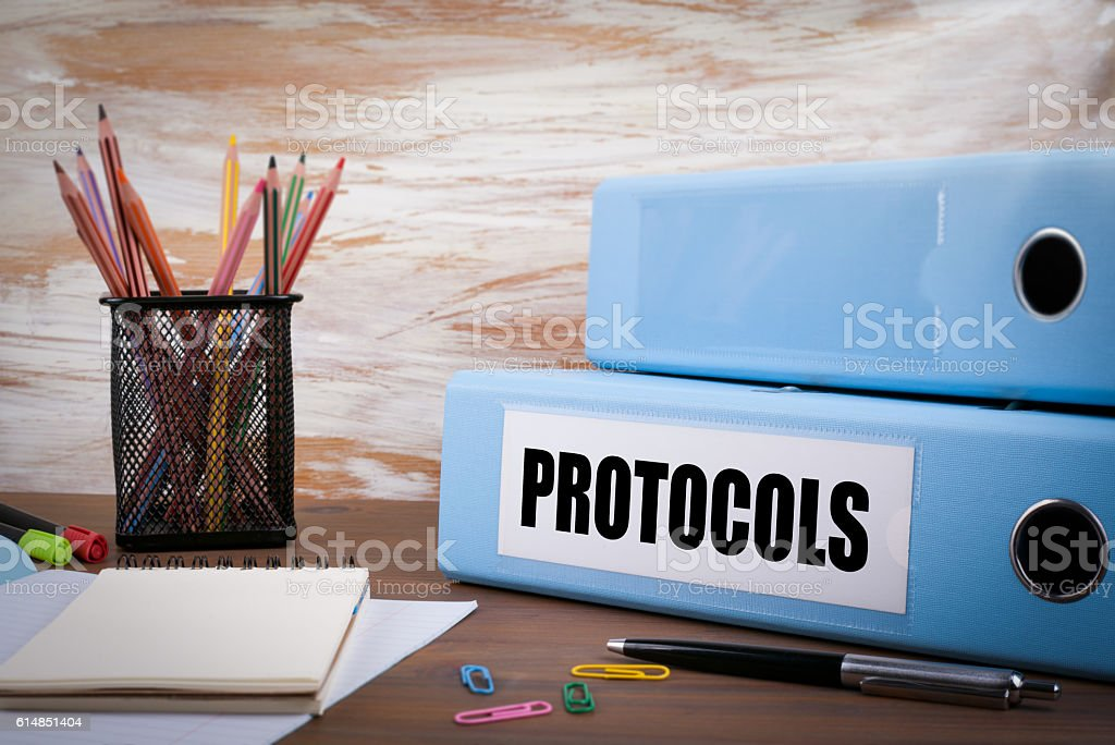 Protocols, Office Binder on Wooden Desk stock photo
