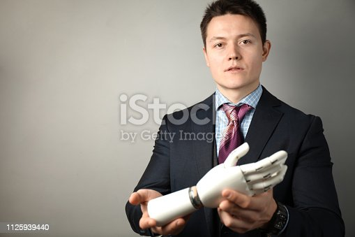 istock Prototype bionic prosthesis in hands of businessman. Restoration and treatment of the disabled 1125939440