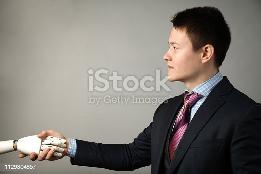 istock Prototype bionic prosthesis in hands of businessman. Restoration and treatment of the disabled 1129304857