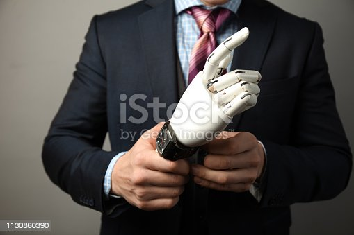 istock Prototype bionic prosthesis in hands of businessman. Restoration and treatment of the disabled 1130860390