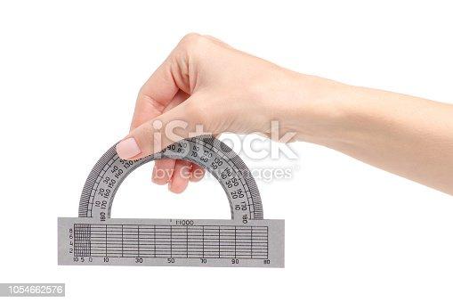 istock Protractor in hand 1054662576