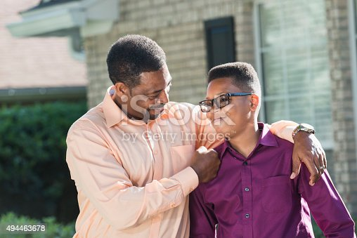 istock Proud African American father with teenage son 494463678