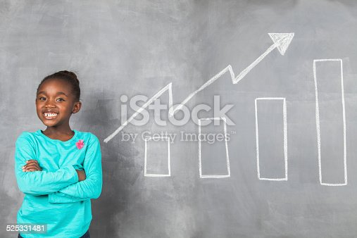 istock Proud african girl showing off her savings growth. 525331481