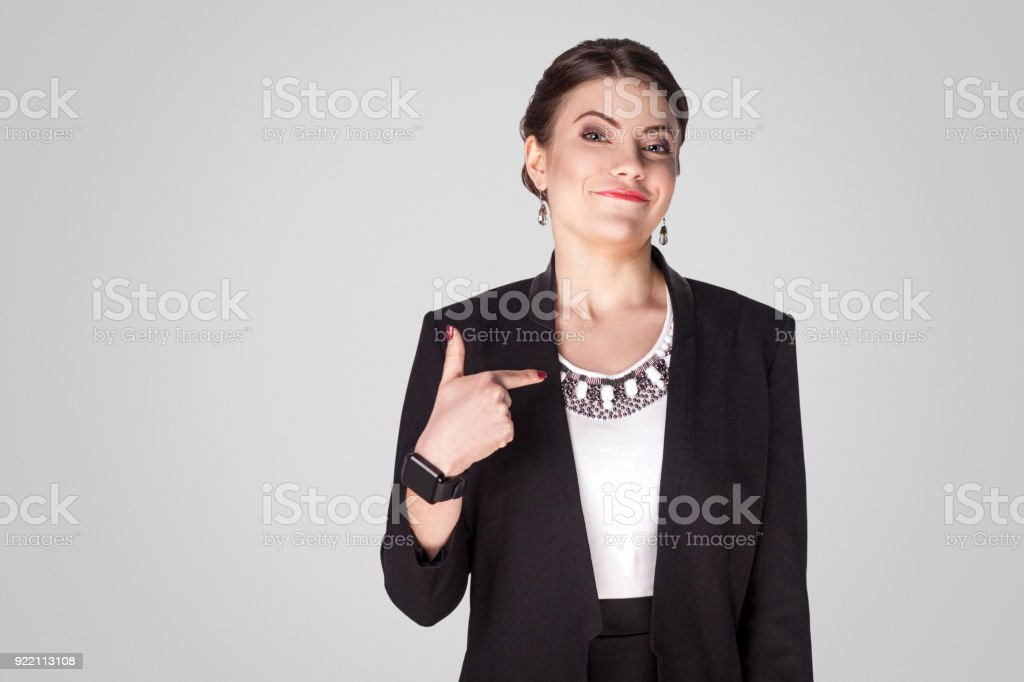 Proud, airy businesswoman pointing finger himself and toothy smile stock photo