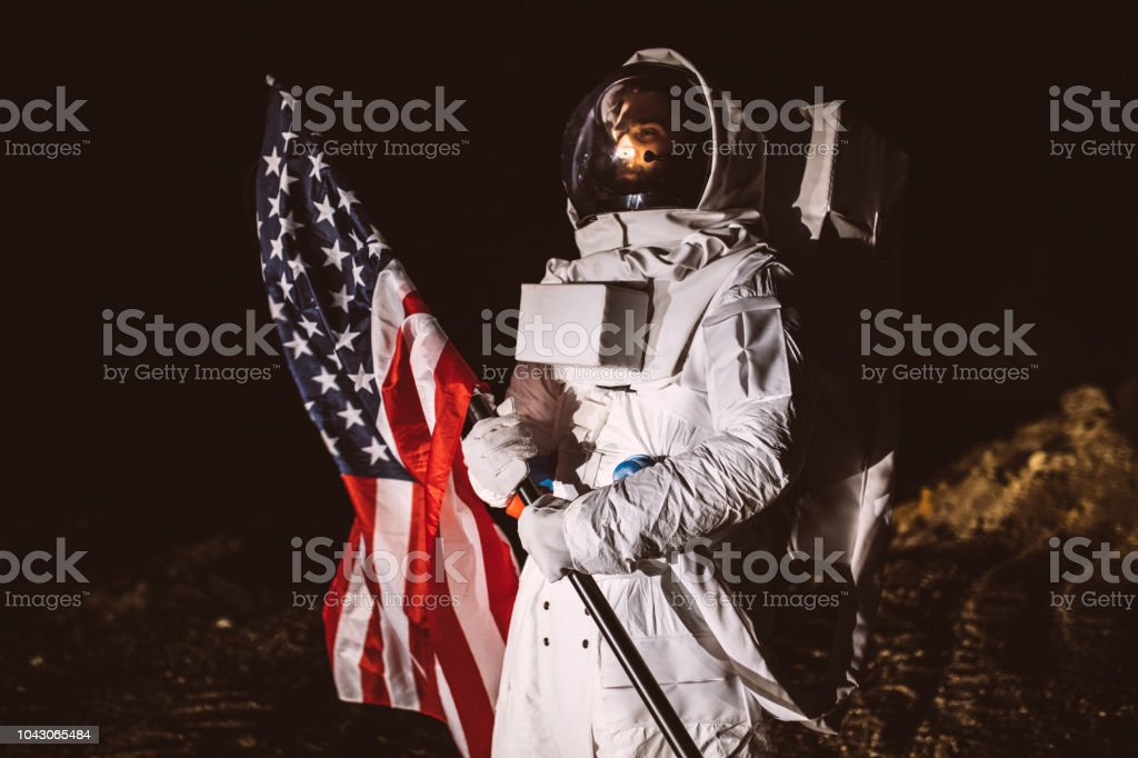 Proud American Astronaut Holding American Flag stock photo