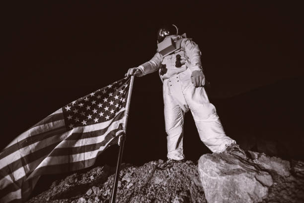 proud american astronaut holding american flag - moon stock pictures, royalty-free photos & images