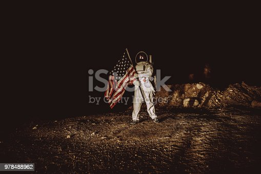 Proud American Astronaut Plant American Flag on the Alien Plane