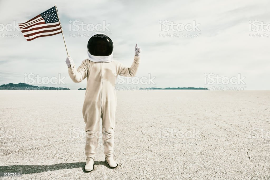 Proud American Astronaut with Flag stock photo