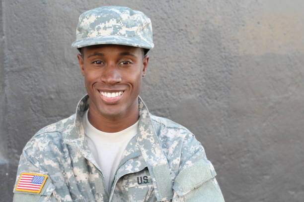 Proud army soldier smiling close up Proud army soldier smiling close up with copy space. sergeant stock pictures, royalty-free photos & images