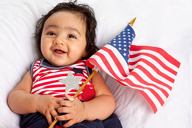Proud Asian American Baby Celebrating July Fourth stock photo