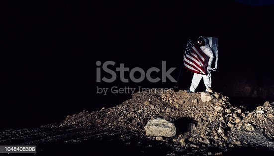 istock Proud Astronaut With American Flag 1048408306