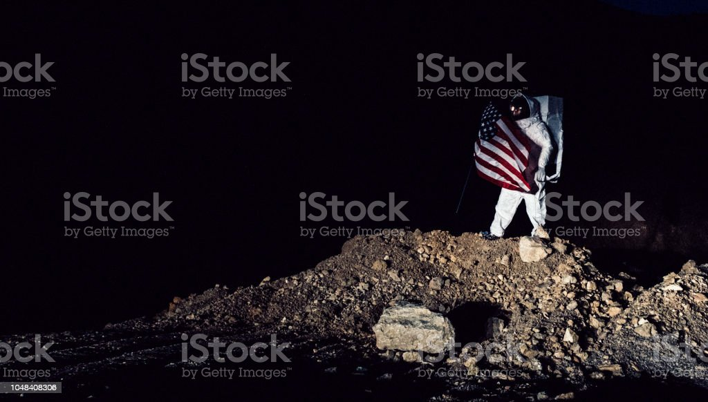 Proud Astronaut With American Flag stock photo