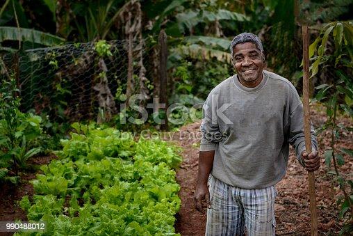 Portrait of a Brazilian farmer next to his home garden.