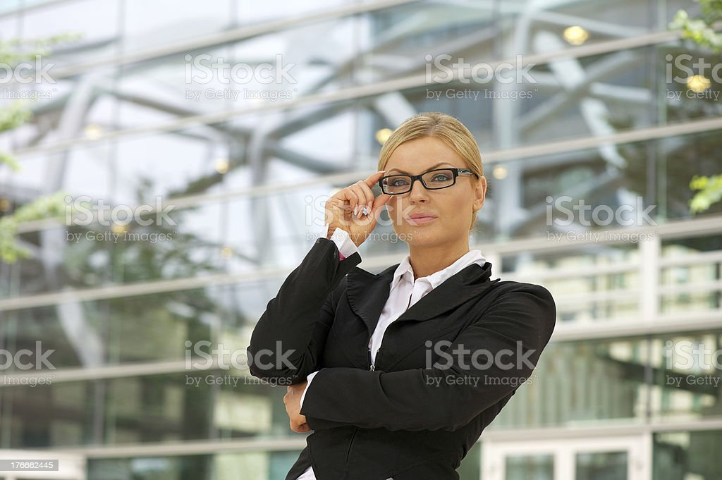 Proud business woman standing in the city royalty-free stock photo