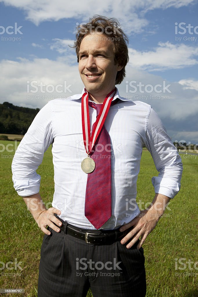 Proud Businessman with gold medal stock photo