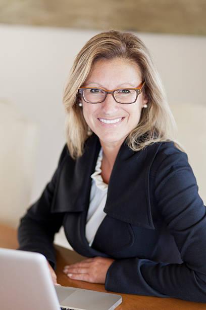 Proud businesswoman at home office using laptop picture id450259541?b=1&k=6&m=450259541&s=612x612&w=0&h=xmcjk8rzfiyvj g dkrprnuieplel59raou2k qmg3w=