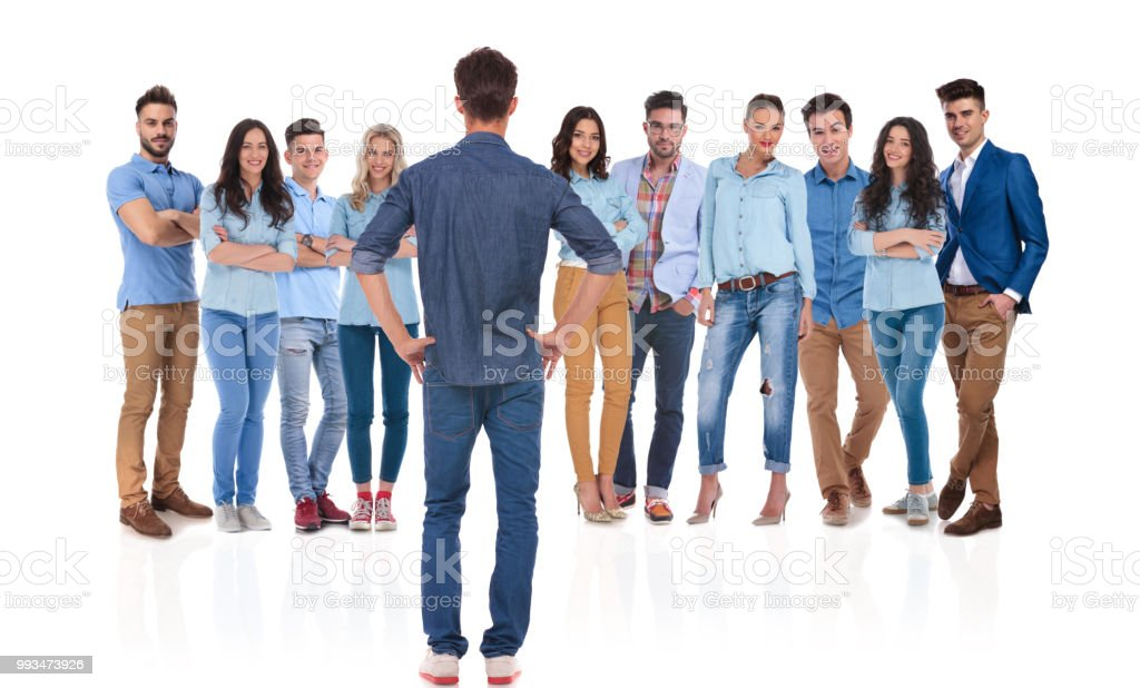 proud casual team leader looking at his team stock photo