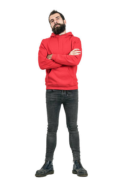 Proud confident bearded man in red hoodie with crossed arms Proud confident bearded man in red hoodie with crossed arms looking at camera. Full body length portrait isolated over white studio background. men in tight jeans stock pictures, royalty-free photos & images