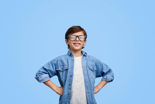 Proud confident boy in eyeglasses stock photo