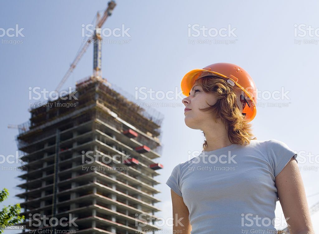 proud constructor in a helmet royalty-free stock photo