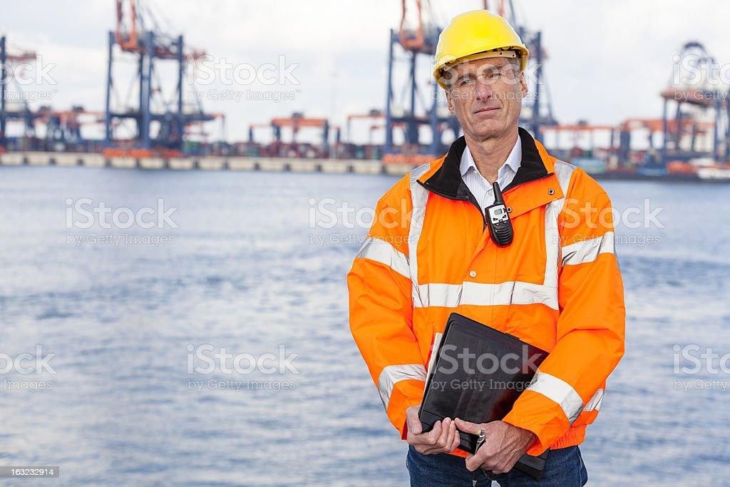 Proud dock worker stock photo