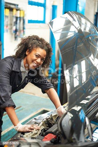 599909112 istock photo proud female auto mechanic 488157620