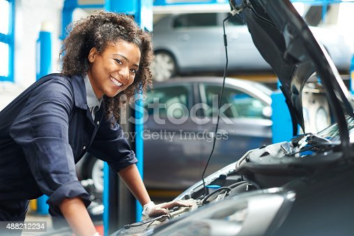 599909112 istock photo proud female auto mechanic 488212234