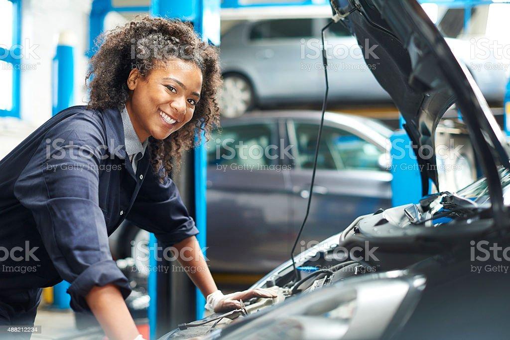 proud female auto mechanic stock photo