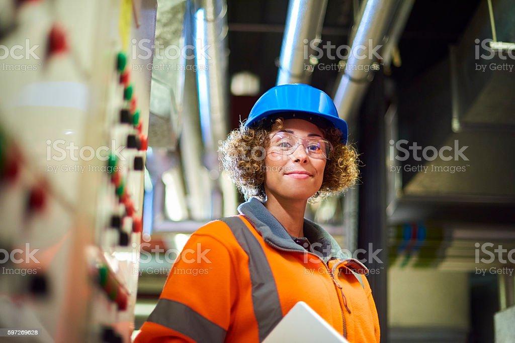 proud female boiler room engineer royalty-free stock photo