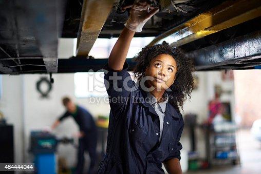 istock proud female garage mechanic . 484444044