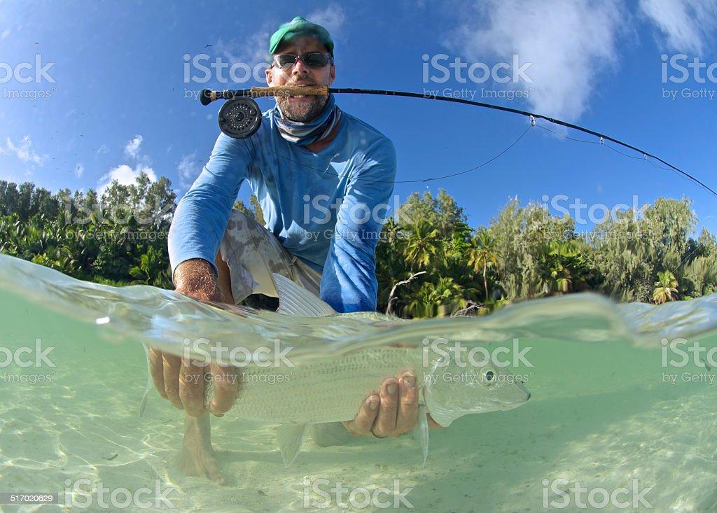 proud fisherman with bonefish stock photo