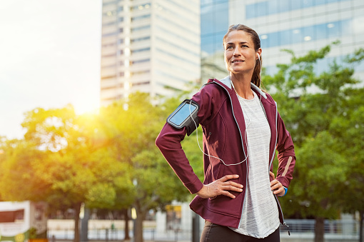 Proud fitness woman looking away