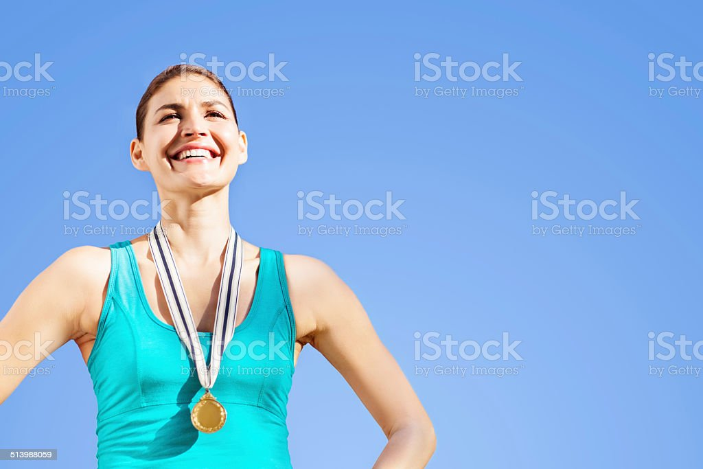 Proud Gold Medalist Against Blue Sky stock photo